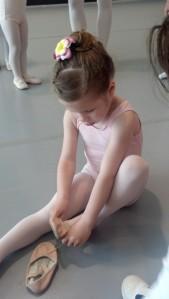 Elli putting on ballet shoes